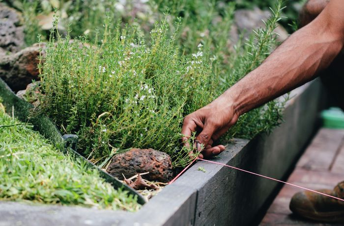 String being used to measure the width of a retaining wall