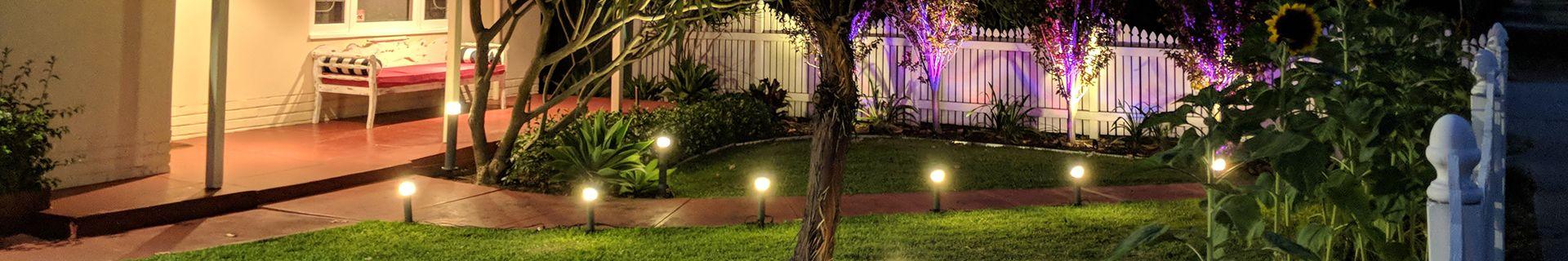 A front garden with a verandah and lighting.