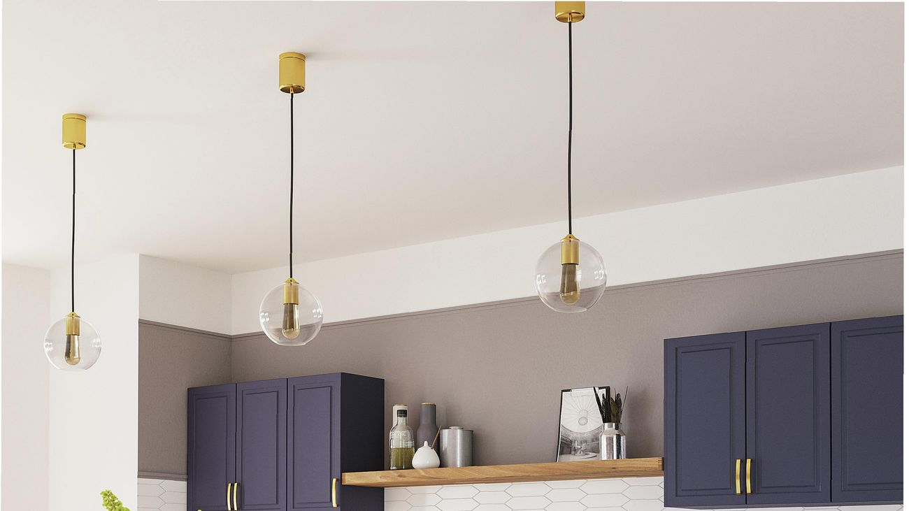 Kitchen with blue cabinets, marble benchtop, white tile splashback, black chairs, gold tapware and hanging pendants