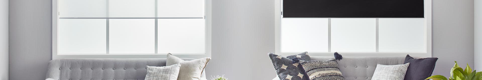 Living room with black roller blinds.