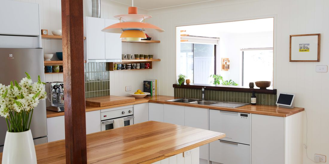 Modern look family kitchen with timber benchtops and warm tones