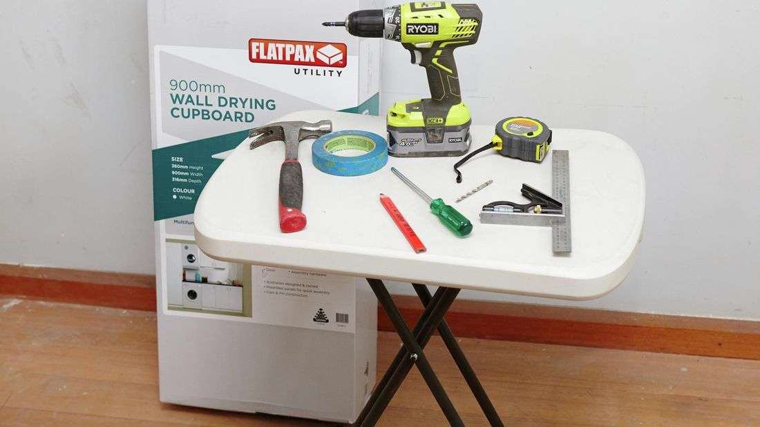 Tools and materials needed to assemble a wall drying cupboard