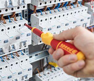 Adjusting a circuit breaker with a Wiha screwdriver