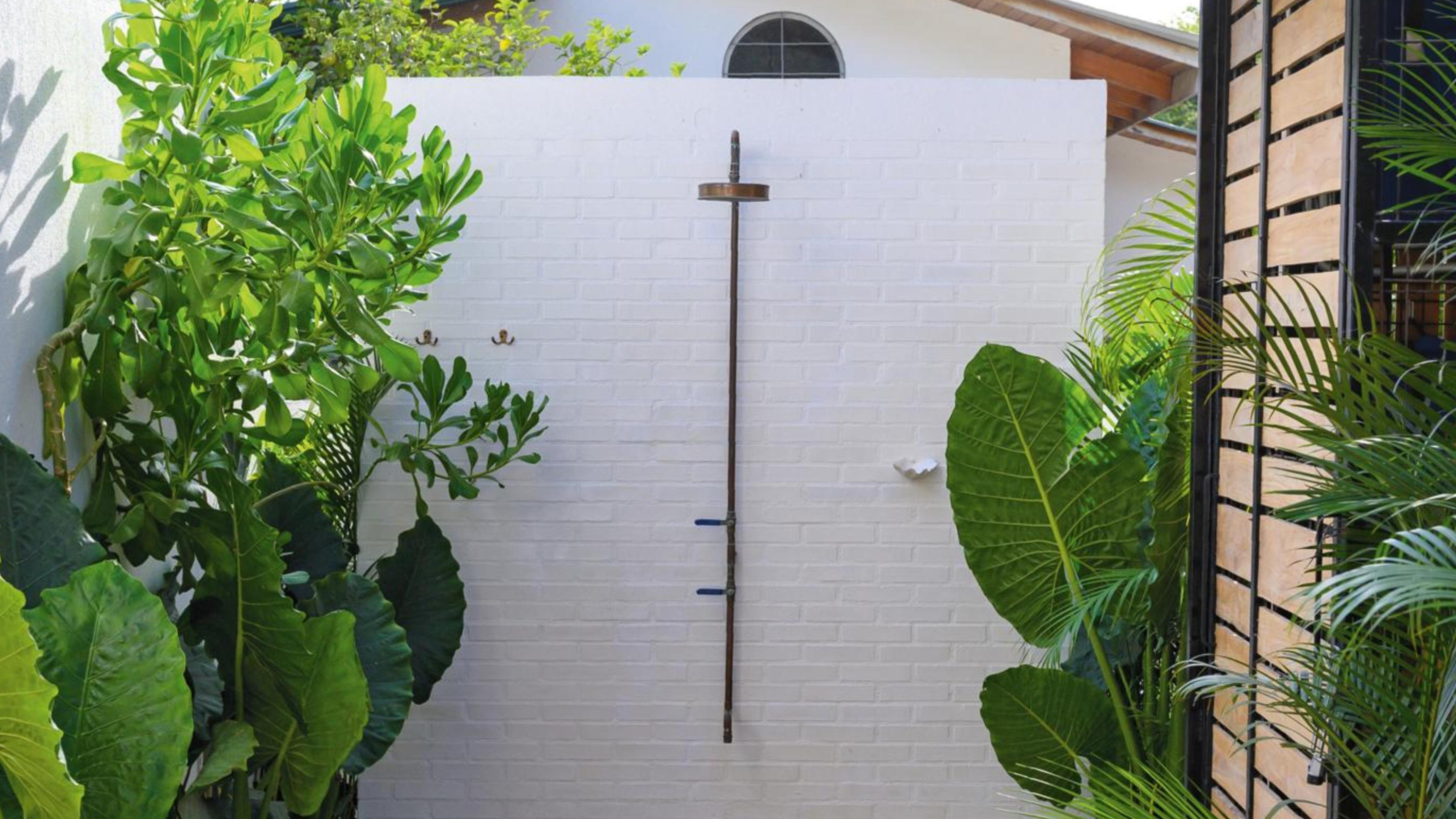 Outdoor shower in retreat area.