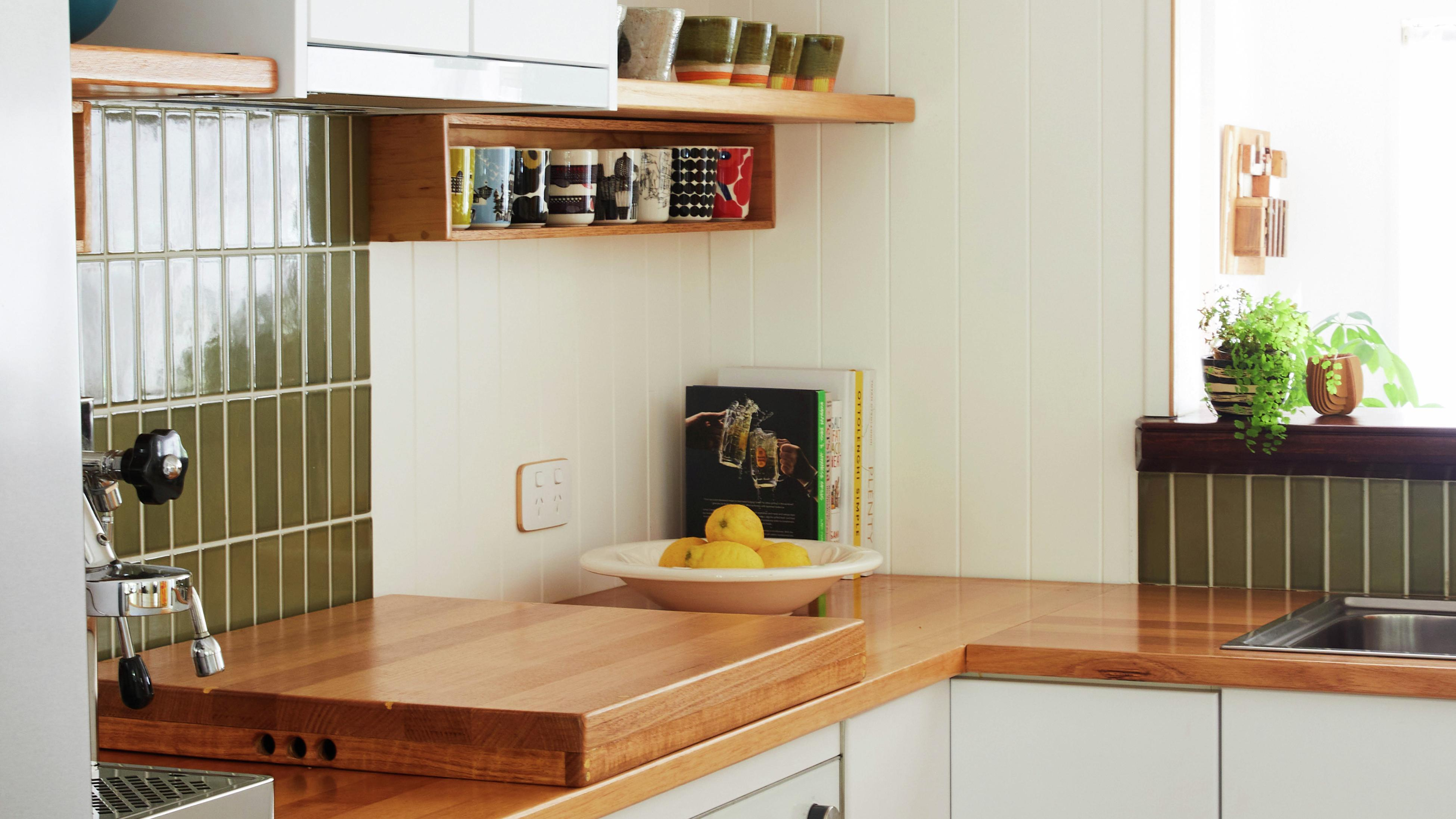 Modern family kitchen with warm tones and timber benchtops