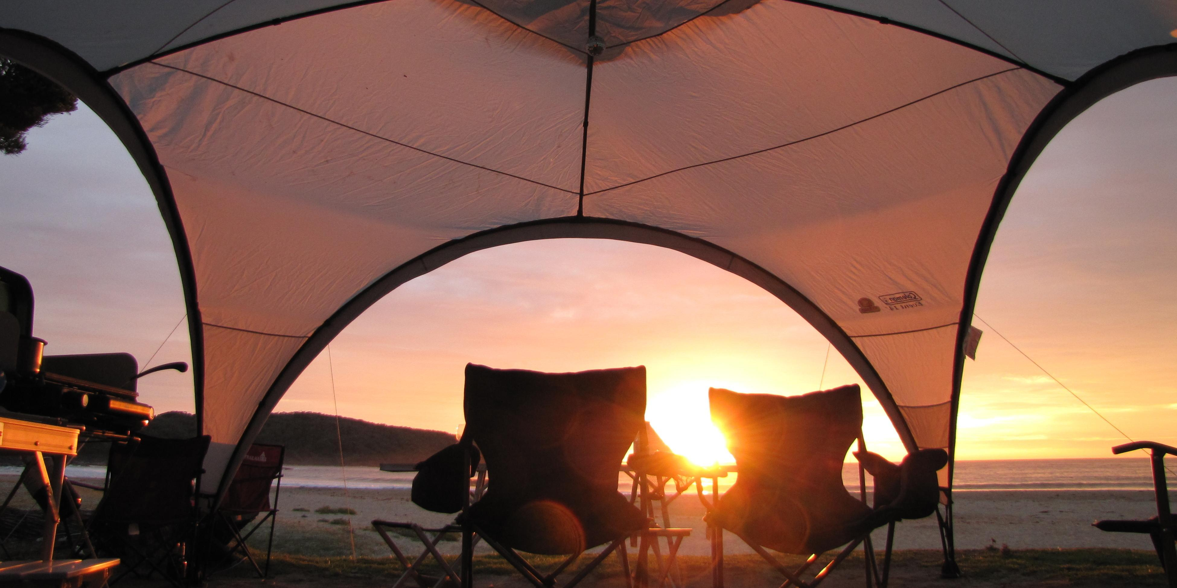 Tent outdoors at sunset