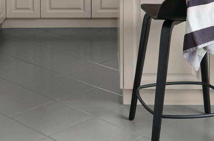 Refreshed kitchen tiles in dark grey colour.