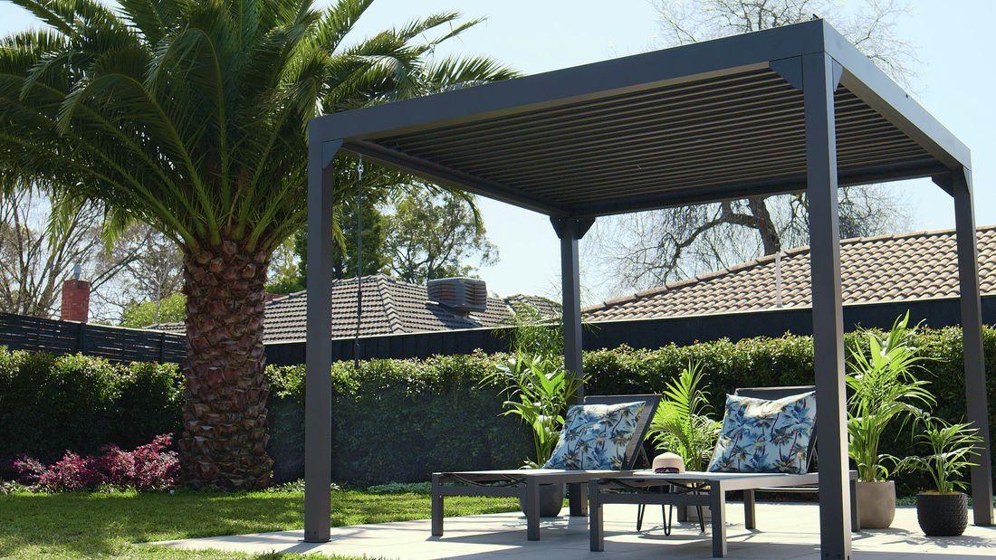 Gazebo over lounge chairs in backyard area.