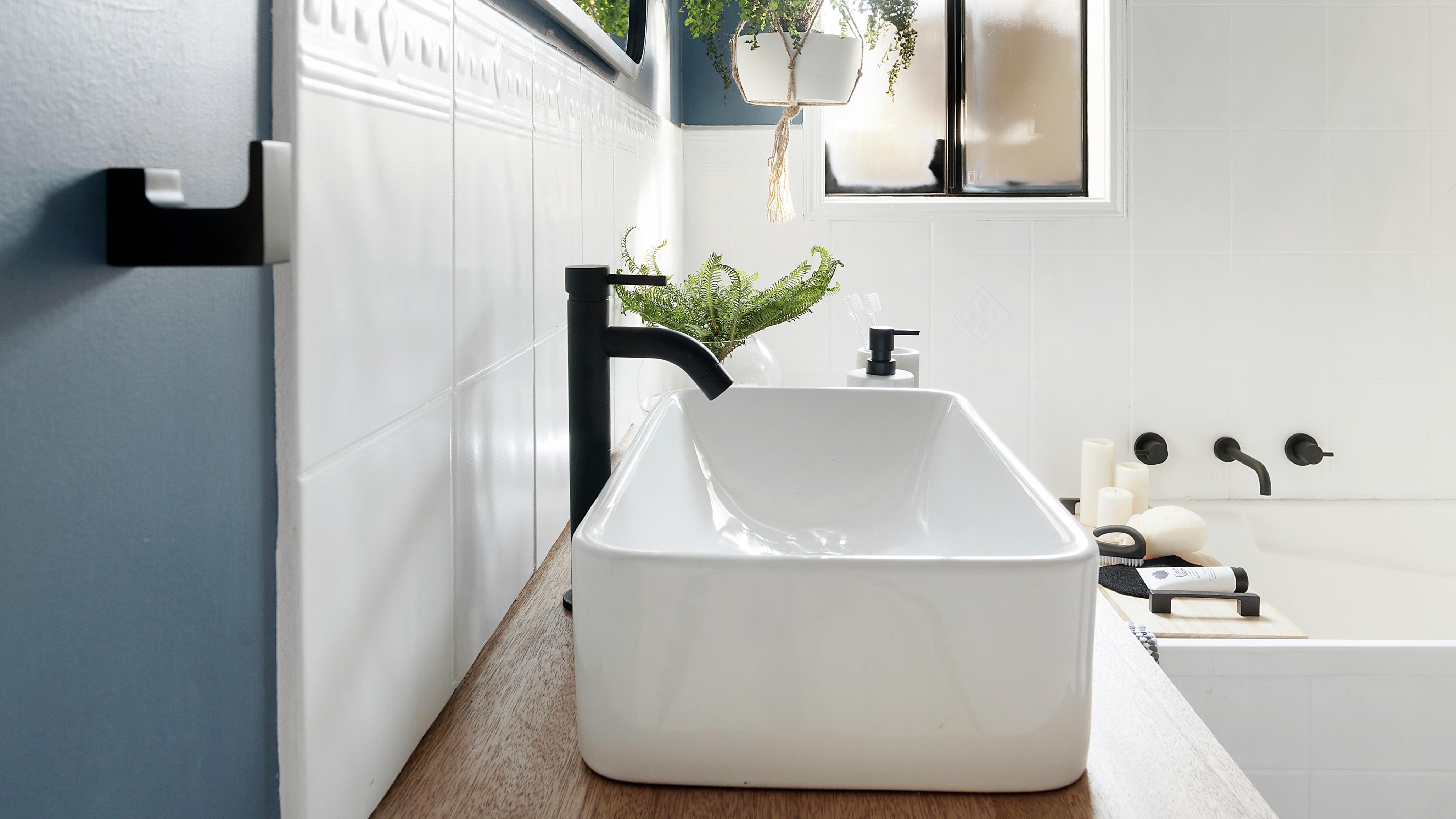 Bathroom featuring black tapware.