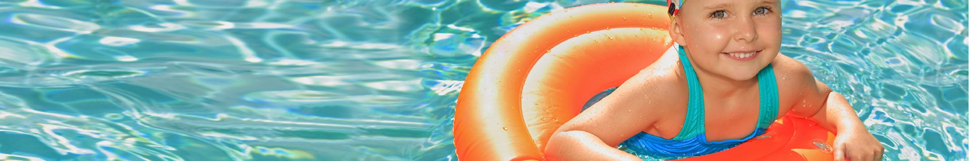 Child swimming in pool on floatie.