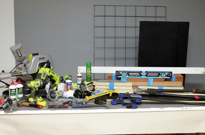 Various tools and materials needed to create a DIY wood and concrete kitchen island.