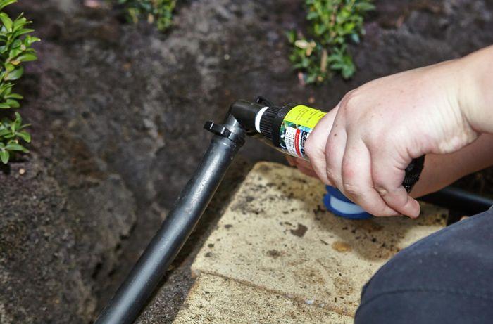 DIY Step Image - How to install pop-up sprinklers . Blob storage upload.