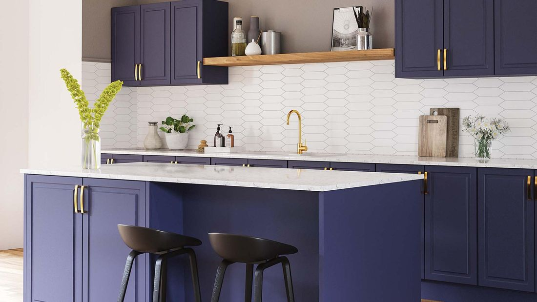 Kitchen with blue cabinets, marble benchtop, white tile splashback, black chairs and gold tapware
