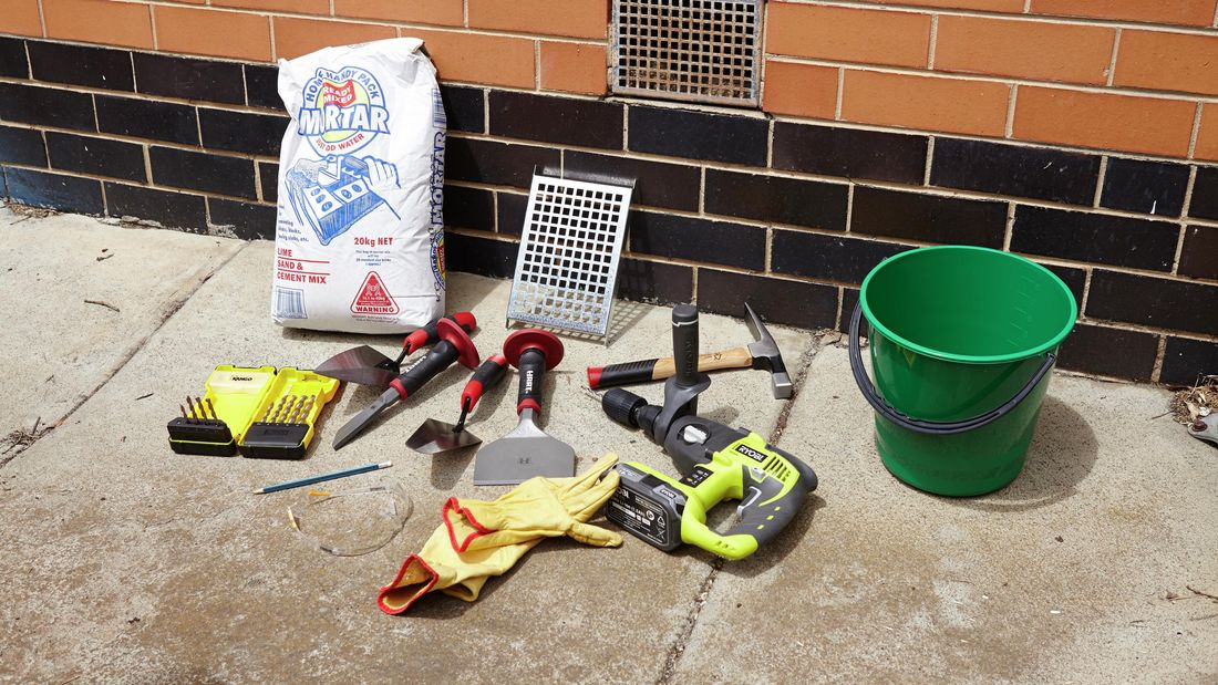 All of the tools and materials you need to replace a vent in a brick wall