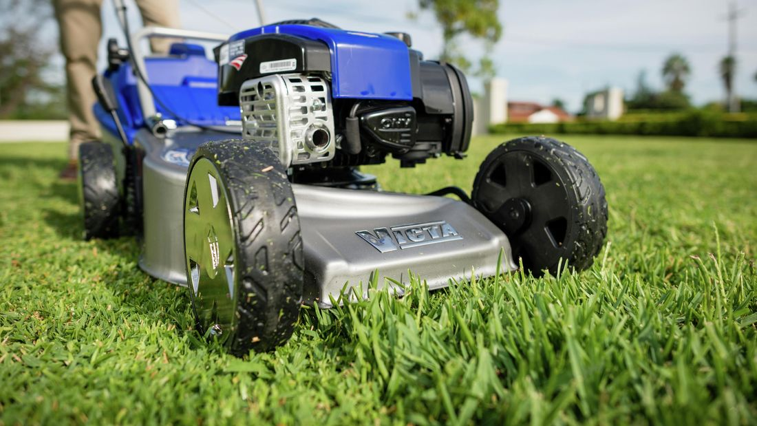 Close up of a Victor Easy Walker lawn mover on the grass.