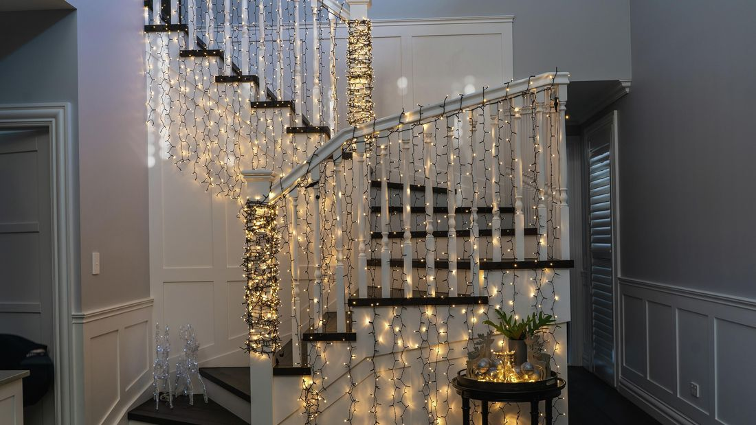 Spiral staircase decorated with gold -toned fairylights