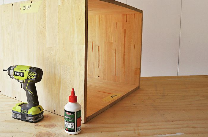 A drill and glue is used to assemble bedside table frame