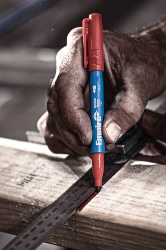 A piece of timber being marked for cutting with a felt tip marker