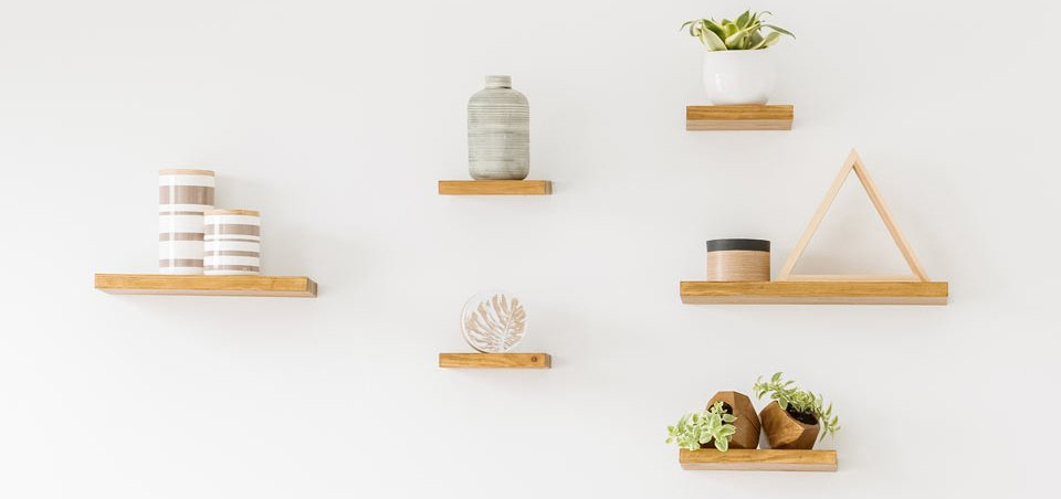 Floating shelves with indoor pot plants and jars