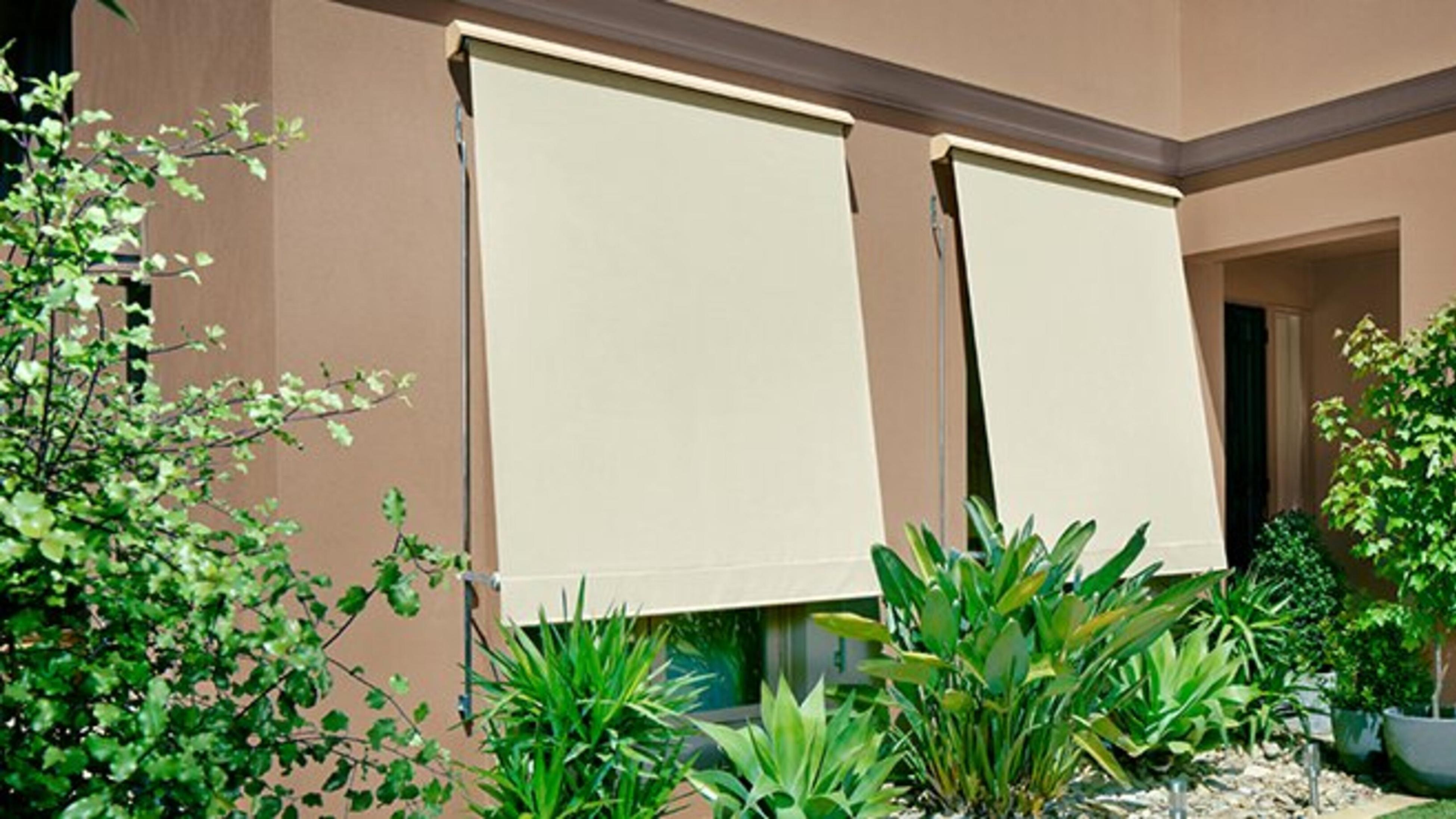 Outdoor blinds and garden area.