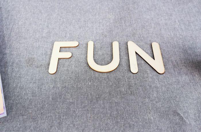 Wooden F U N letters.