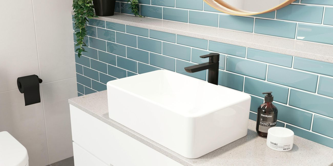 Black matte tap with white bathroom basin