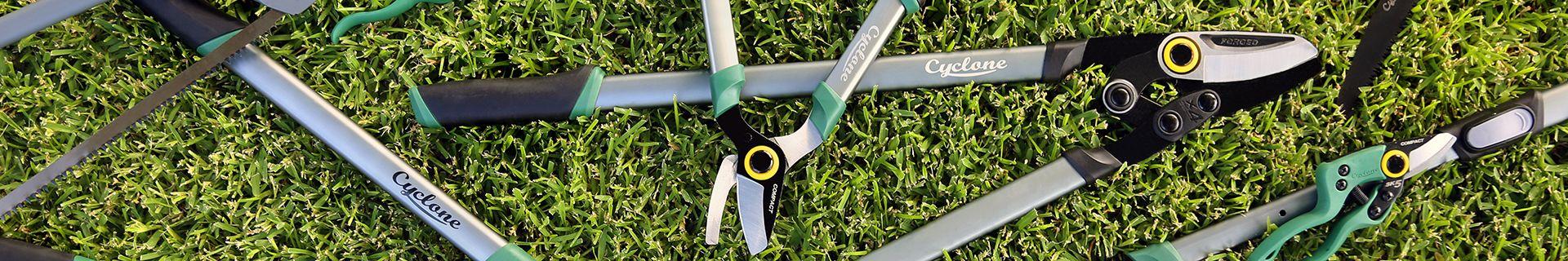 Garden hand tools lying on grass.