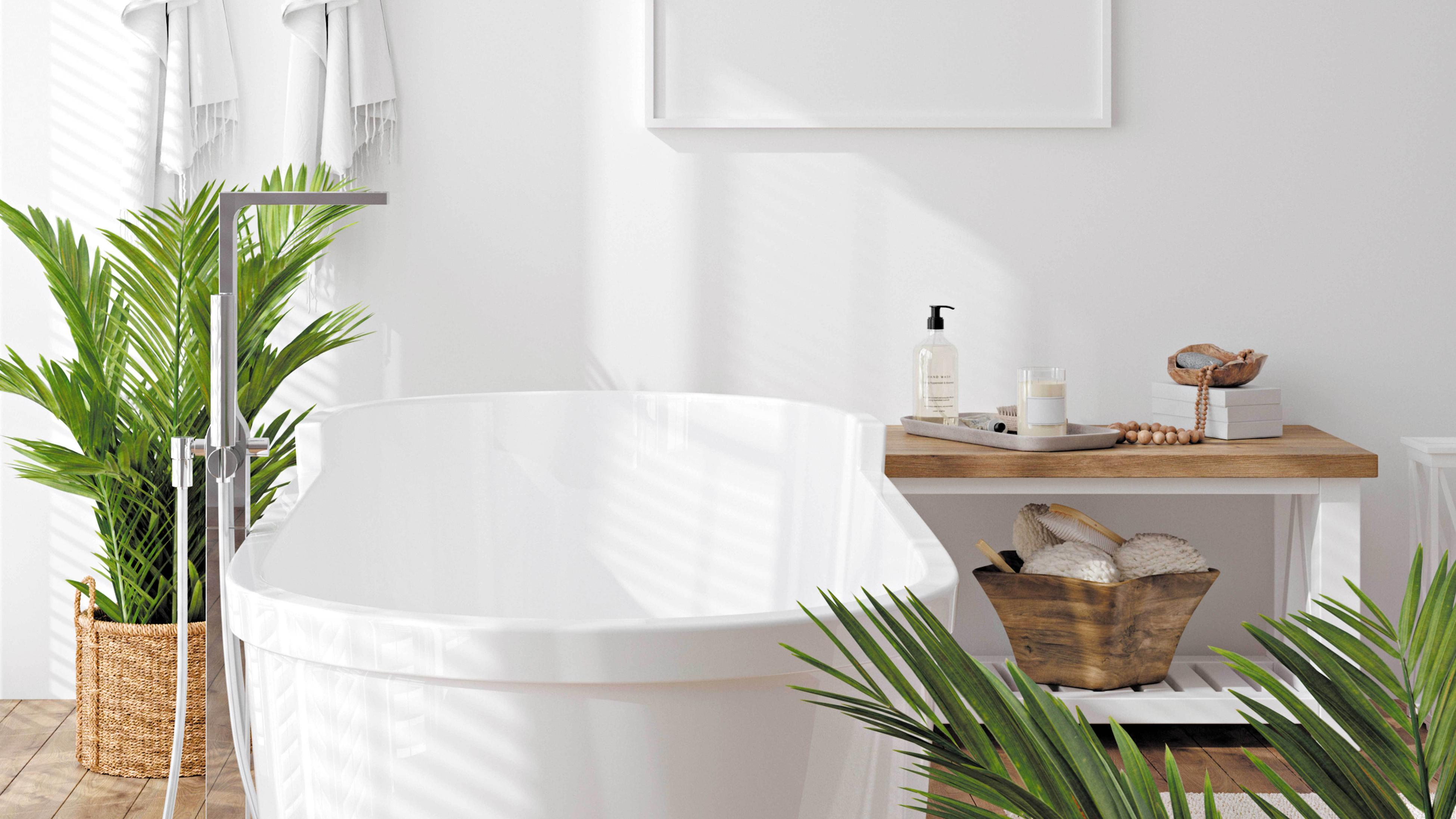 A white freestanding bath in a bathroom with timber floors.
