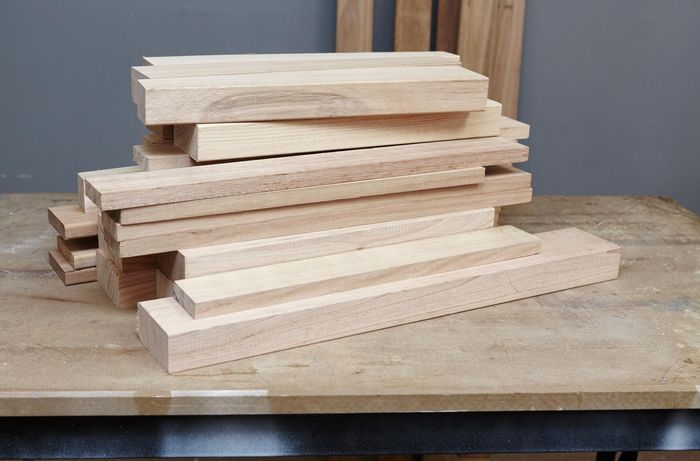 A pile of wooden plants to be used in the construction of outdoor furniture