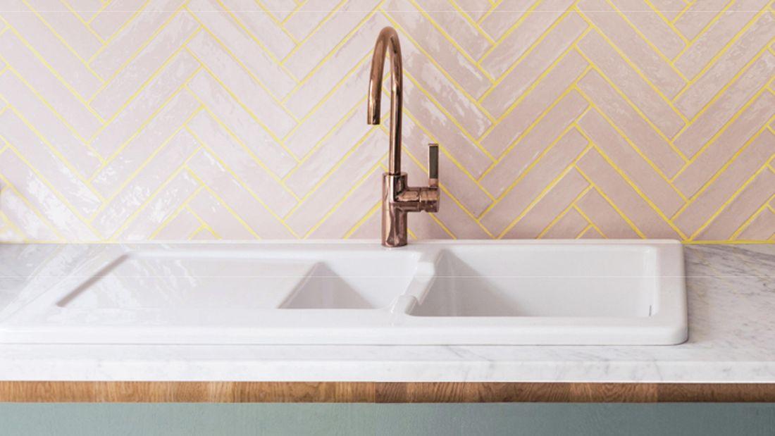 Bathroom tiles with a sink.