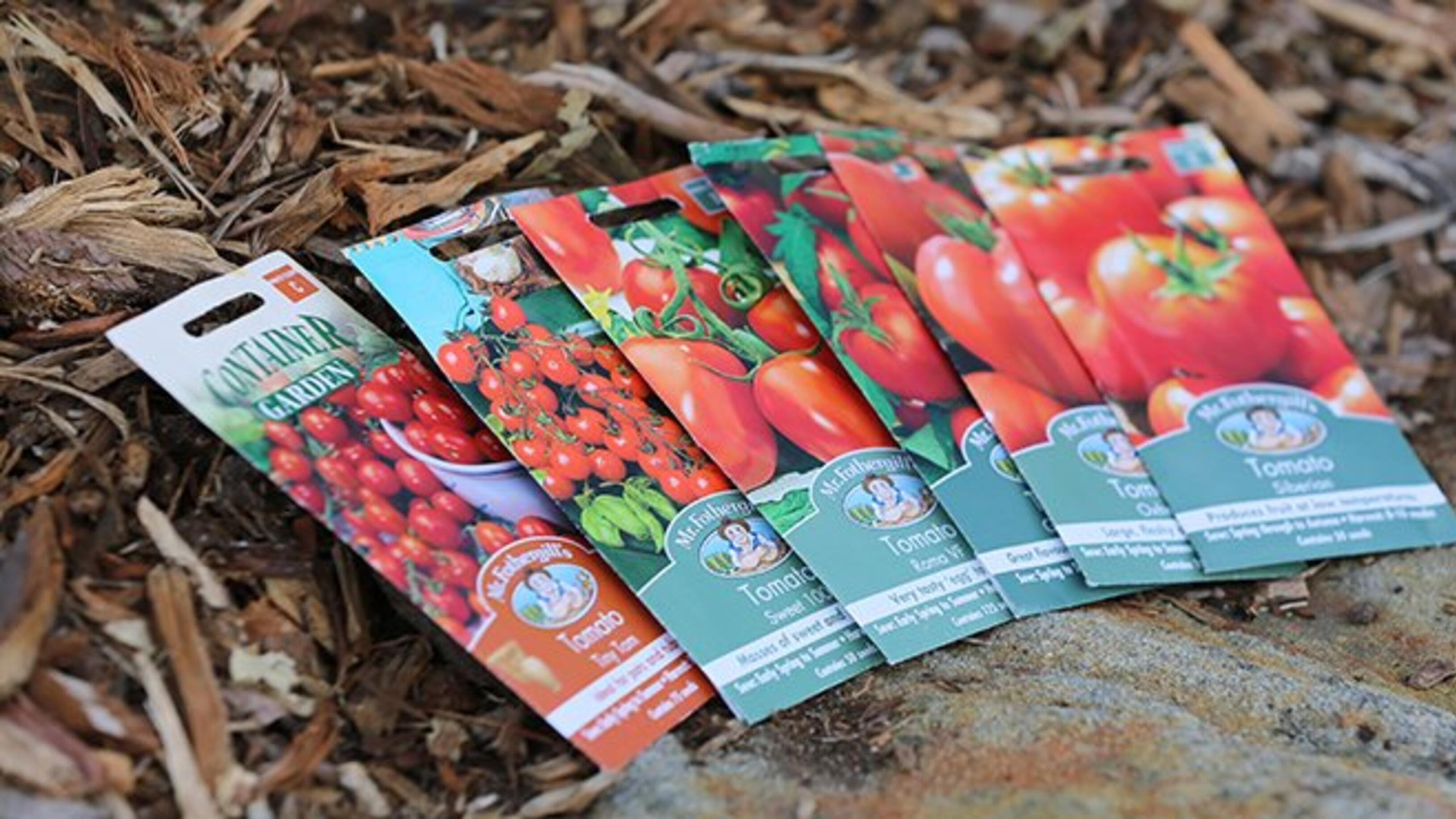 Six different varieties of tomatoes in seed packets.