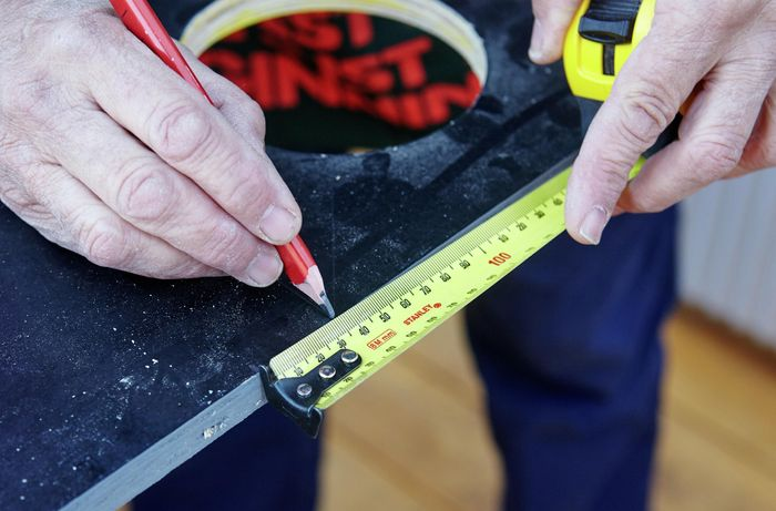 A tape measure being used to mark the vertical garden tier for cutting