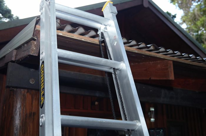 Ladder resting against a corrugated metal roof