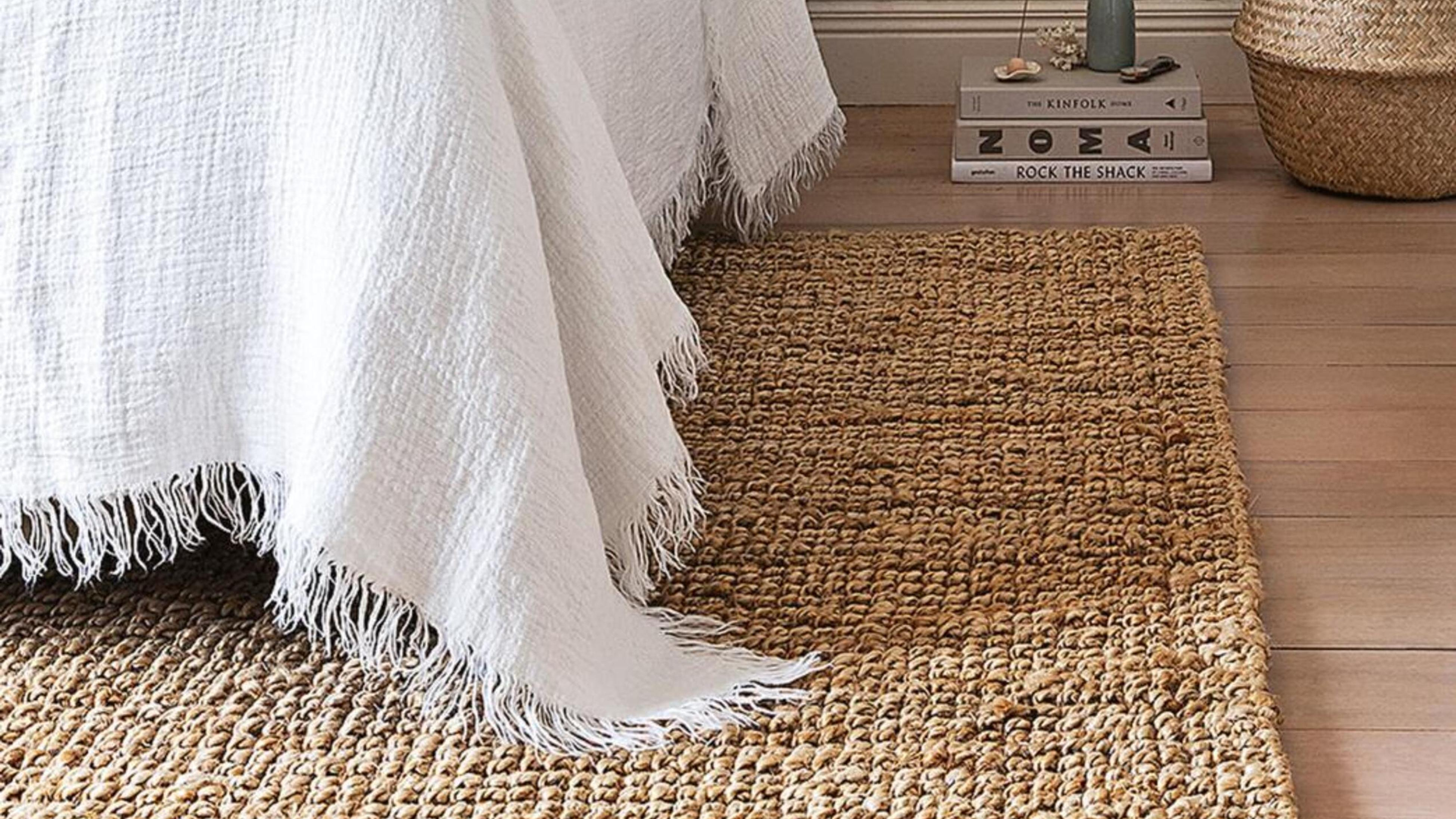 Bed on top of rug.