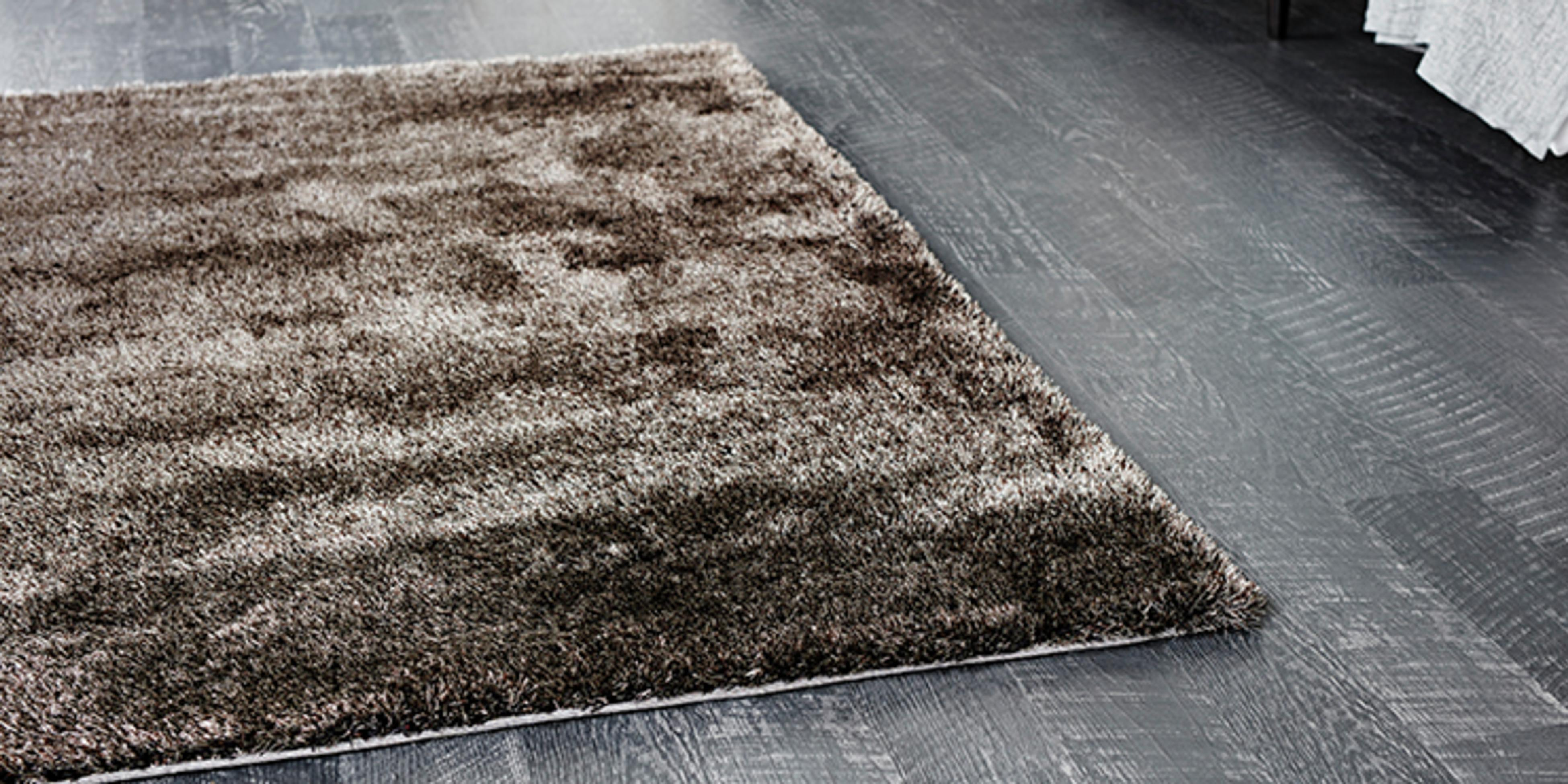 Shaggy rug in a living room with timber floorboards
