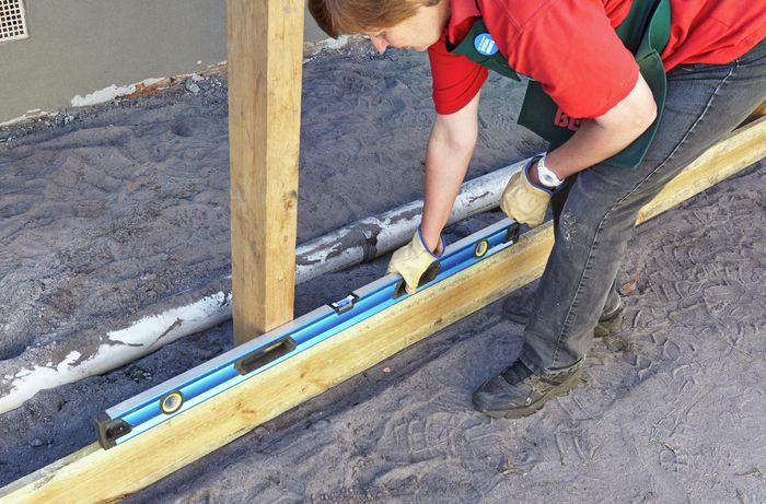 DIY Step Image - How to install rails and plinths for a paling fence . Blob storage upload.