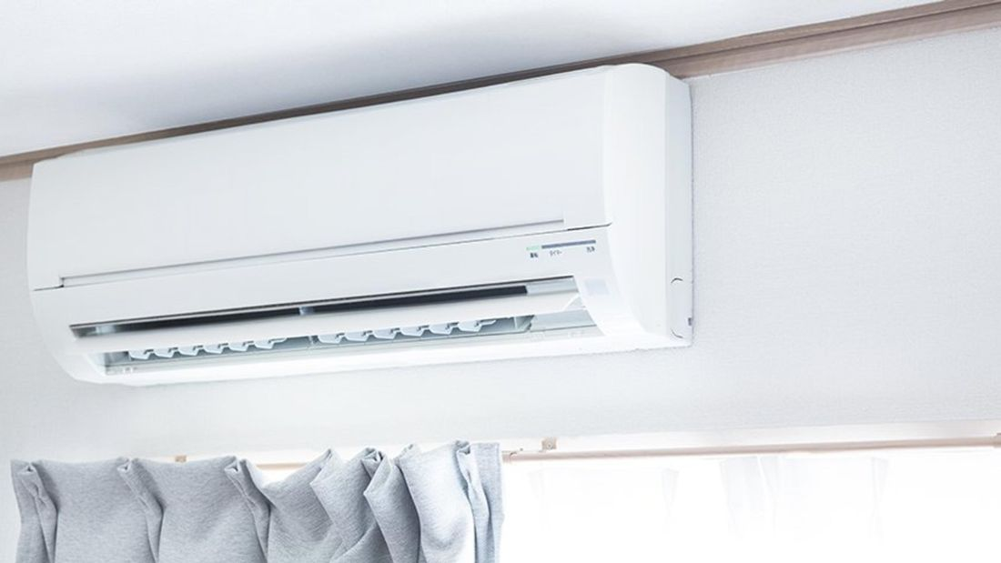 Split system air conditioner installed above the curtains.